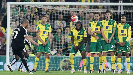 Adlene Guedioura takes a free-kick for Watford in the final Premier League match Carrow Road is set