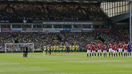 Players and fans ahead of kick-off at Carrow Road between Norwich City and Manchester United. Pictur