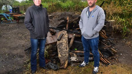 Lisa Lucas and Steven Shillings by the remains of the burnt out shed.
