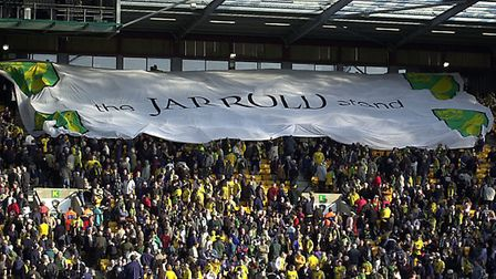 A huge banner flows over the crowd at Carrow Road to open the new Jarrold Stand in 2004.