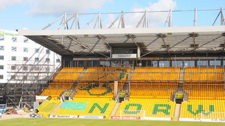 Scaffolding going up on the Jarrold Stand at NCFC's Carrow Road ground. Photo: Steve Adams