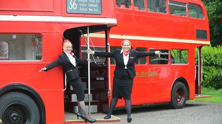 Kim Wells (left) and Lauren Brown on board one of their buses. Picture: Ian Burt