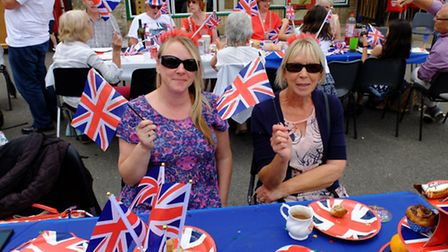 Tracy Lock, left, with Pauline Barrett, right at the Thetford street party for the Queen's 90th birt