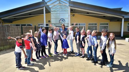 Bluebell Primary School headteacher Trudi Sharred and pupils celebrate their Ofsted result.Picture: