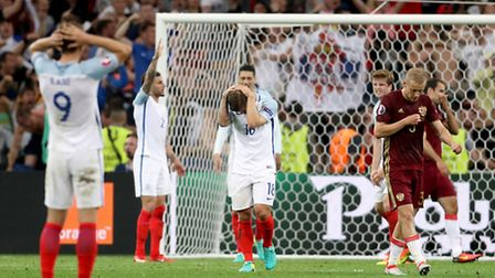 England's Jack Wilshere (centre) stands dejected with team-mates after seeing his side concede a goa