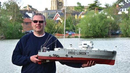Paul Scripps with his model Radio London ship made for him by a family of model boat builders in Fra