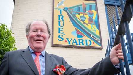 Sir Jeremy Bagge unviels the restored sign at True's Yard, King's Lynn. Picture: Paul Tibbs