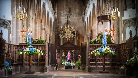Finishing touches are made ready for the Walpole St Peter Church Flower Festival. Photo: Paul Tibbs