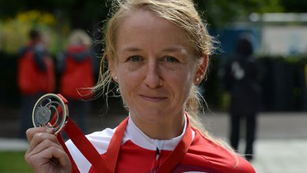 England's Emma Pooley, pictured with the silver medal she won in the time trial during the 2014 Comm