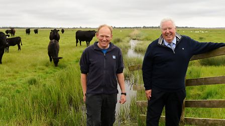 RSPB site manager Mark Smart and grazier Barry Brooks on Berney Marshes. Picture: James Bass