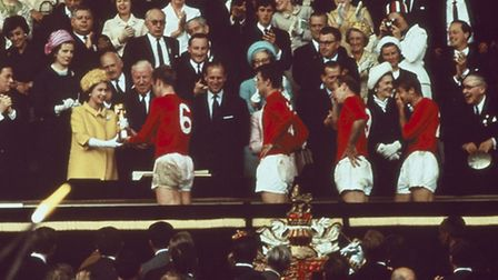 England captain Bobby Moore receives the trophy from the Queen after his teams win at the 1966 World