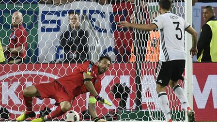 Germany's Jonas Hector scores the winning penalty past Italy goalkeeper Gianluigi Buffon during the