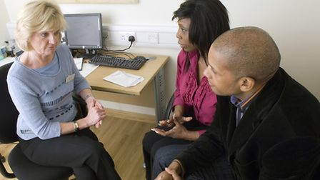 Mental Health. Pictured: A doctor and couple discuss depression. Picture: Time to change/Newscast O
