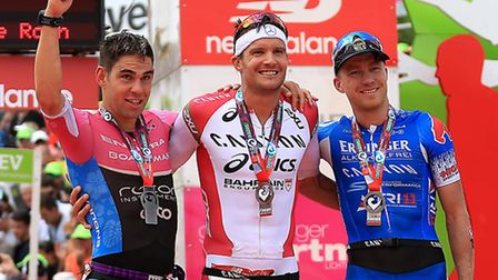 Winner Jan Frodeno of Germany, second place Joe Skipper (left) of Great Britain and third place Nils
