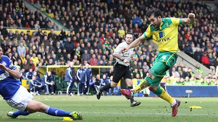 Bradley Johnson scores Norwich City's first against Ipswich Town at Carrow Road in 2015. Picture: Pa