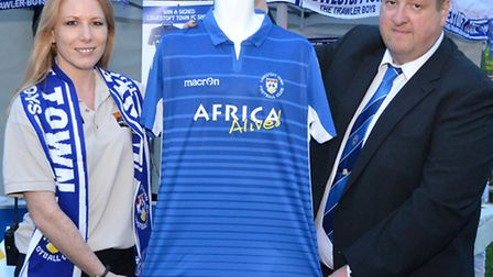 Africa Alive! park manager Kirsty Dupee with Lowestoft Town chairman Gary Keyzor.