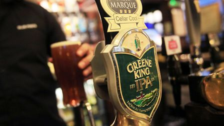 File photo dated 07/03/11 of a pint of Greene King IPA ale being poured. Picture: Yui Mok/PA Wire