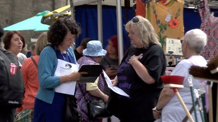 Members of PAIN - Pension Action in Norfolk - collect signatures in North Walsham Market Place as pa