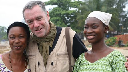 Former EDP deputy editor James Ruddy with Tenneh Cole (right) and her aunt Mariama Mansaiy