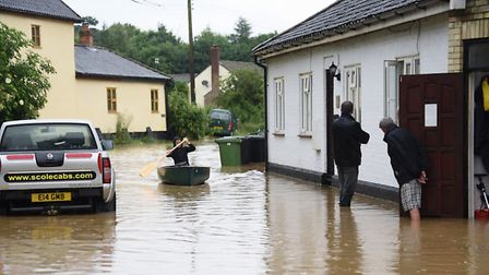 Residents at the flooding at Low Road at Scole. Picture: DENISE BRADLEY