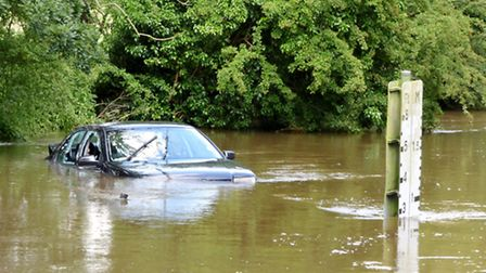 Car in flood water in Shotesham Ford. Picture: Zak Nelson.