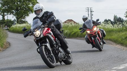 Motoring editor Andy Russell is coached on cornering for his Hugger's Challenge by Andy Micklethwait
