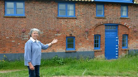 Deborah Sheppard outside the house at Burnham Overy Staithe which inspired her mother's story Marnie