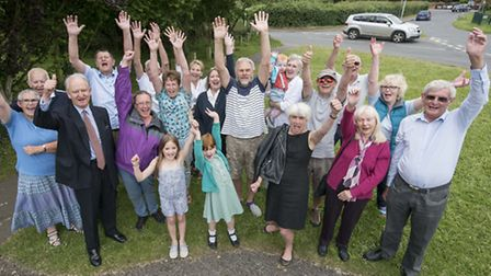 Villagers at Heacahm celebrate their victory over the new housing proposal on Station Road, with MP