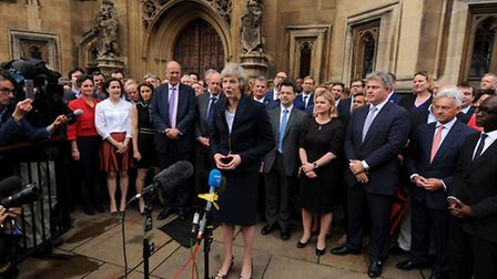Theresa May outside the Houses of Parliament in Westminster, London, after she secured her place as