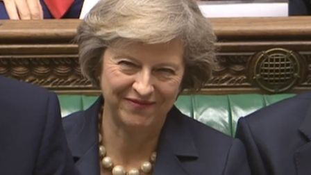 Prime Minister David Cameron speaks during his last Prime Minister's Questions, flanked by Theresa M