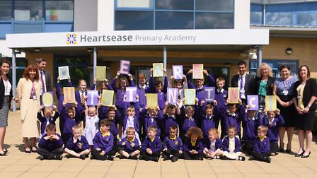 Children and staff from Heartsease Primary Academy celebrate their outstanding Ofsted. Picture: DENI