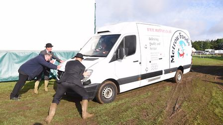 Going firm to soft at The Royal Norfolk Showground as staff attempt to help a stranded van. Photo: S