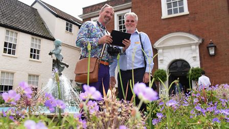 Judges Ed Hooker III, left, and Bill Ivison, study the garden at the Assembly House for the Internat