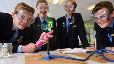 Flegg High School who have recently had a good Ofsted report. Pupils taking part in a science experi