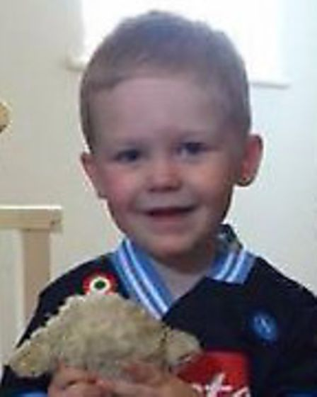 Owen with Lamby, who was lost at the Royal Norfolk Show on Wednesday.