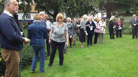 Some of the 50 or so people who gathered around the East window of North Walsham Parish Church, whic