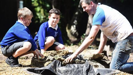 MARS staff are helping to create a wildlife area at Narborough Primary School. Pictured with Paul Do