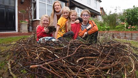 Claire Gebbett with her children and a friend, in the giant nest they, and local children have been