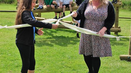 Head teacher Christine Mead opening the new outdoor play area at Colby School.