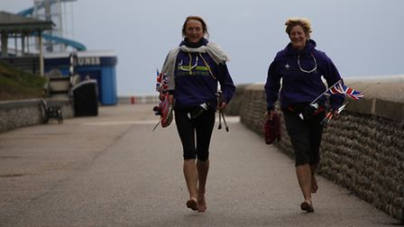 Sally King and Anita Lusher finish their 52 miles in a day walking challenge at Cromer Pier. Picture