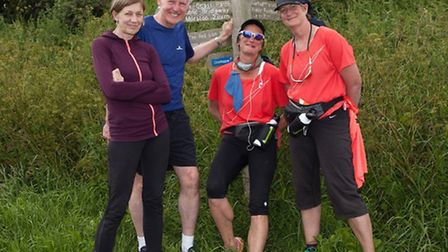 Norman and Mary Lamb with 52 mile charity walkers Sally King and Anita Lusher
