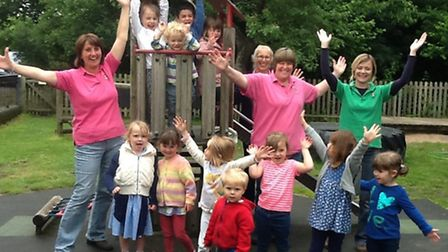 Staff and children from Gissing Children's Centre celebrate their outstanding Ofsted rating. Picture