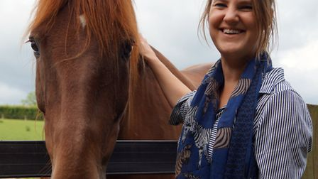 Head of fundraising at Redwings Gemma Walpole, pictured with Dennis the horse, will be running 10K t