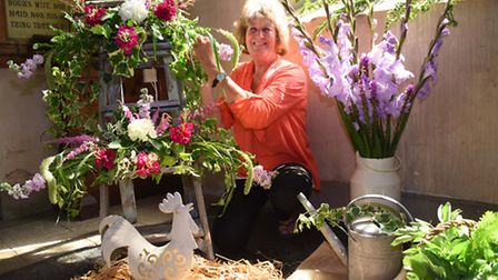 The Fun with Flowers festival being set up at St Peter's Church at Ringland. Margaret Miller works o