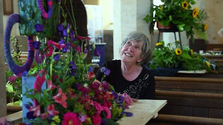 The Fun with Flowers festival being set up at St Peter's Church at Ringland. Sue Hunt admires a disp