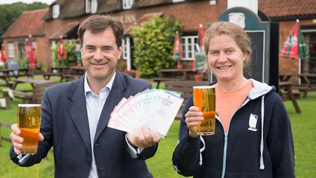 Rupert Farquharson and Belinda Jennings from Woodforde's toast the launch of the Summer of Pubs camp