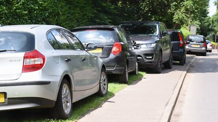 Cars parked on Low Road on the pavements as the new Thai Temple opened in Orchard Drive at Hellesdon