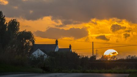 The sun sets over Saddlebow, near the site of King's Lynn Incinerator. Picture: Matthew Usher.