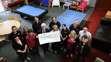 Norman Lamb MP presents a cheque to the Holt Youth Project for £1,772. Picture: MARK BULLIMORE