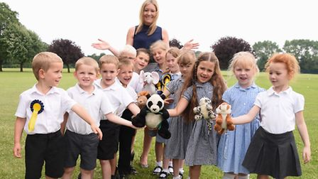 Headteacher Louise Robinson with some of the children, and their class mascots, at Kinsale Avenue In